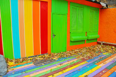 Colorful house. Bright colorful  wall facade with green door Stock Photo