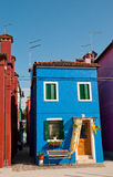 Colorful house in Burano. With a bench Stock Images