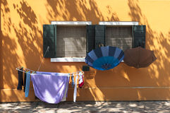 Colorful house of Burano Island with laundry, Venice, Italy Stock Images