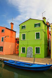 Colorful house by canal in Burano, Venice, Italy. Stock Images
