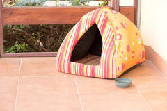 Colorful house for cat, outdoor. Colorful house for cat made of textile fabric, outdoor stock photo