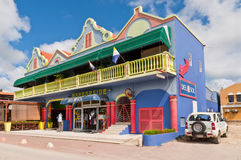 Colorful house of City Center, Kralendijk, Bonaire. Kralendijk, Bonaire - December 2, 2011: On Main Street, Kralendijk, stand a colorful house containing shop Stock Photos