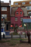 Colorful house in Hastings Old Town East Sussex UK. Colorful house in Hastings Old Town with large old ships anchor Stock Photos