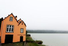 Colorful House By The Lake Royalty Free Stock Photos