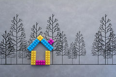 Colorful house model with drawing of tree on grey background Royalty Free Stock Photos