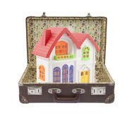 Colorful house in old suitcase Stock Photos