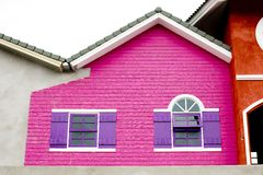 Colorful house, pink and violet color of wood house. Royalty Free Stock Photography