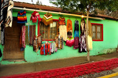 Colorful house with a sale of clothes Stock Images