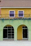 Colorful house with violet and white windows Royalty Free Stock Photography