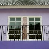 Colorful house with violet and white windows Royalty Free Stock Photo