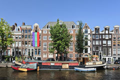 Colorful houseboat in Amsterdam Old Town. Royalty Free Stock Photos