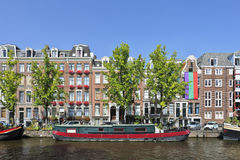 Colorful houseboat in Amsterdam Old Town. Stock Photos
