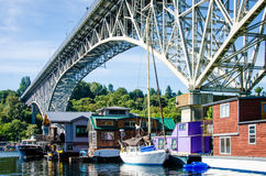 Colorful houseboats in Freemont, Seattle. Colorful houseboats are moored below the George Washington Bridge in Freemont, a funky neighborhood in the Pacific Stock Photo