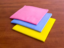 Colorful household cleaning wipes. On the wooden surface of the table royalty free stock photo