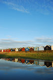 Colorful houses. Very colorful beach huts reflected in water Stock Photo