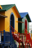 Colorful Houses. They are made up of yellow, green and blue. Each element of the house is a different color. These houses are holiday homes by the sea royalty free stock photo