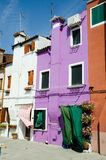 Colorful houses. Along canal on Burano island, near Venice Italy Royalty Free Stock Images
