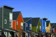 Colorful Houses. A row of brand new, colorful houses Royalty Free Stock Images
