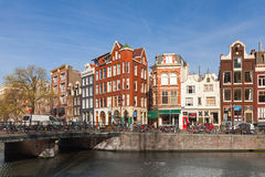 Colorful houses along the canal embankment in spring day Stock Photography