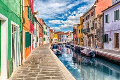 Colorful houses along the canal, island of Burano, Venice, Italy Royalty Free Stock Image