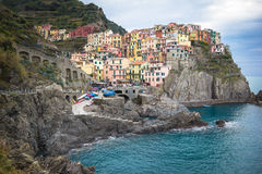 Colorful houses along a cliffside in the village of Manarola Italy. Stock Image