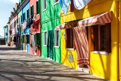 Colorful houses alongside the canal in Burano island royalty free stock photo