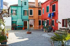 Colorful houses alongside the canal in Burano island stock photography