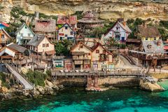 Colorful houses in Anchor Bay, Popeye Village,Malta.  Royalty Free Stock Images