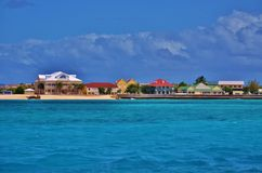 Colorful houses on a bay. Beautiful, colorful houses on a beach in the Caribbean Sea Stock Photos