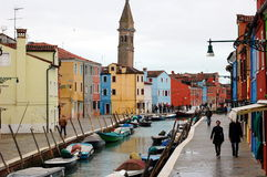 Colorful houses and boats along Burano canal, Venice, Italy Royalty Free Stock Photography