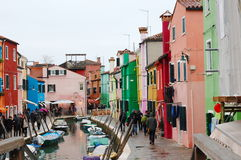 Colorful houses and boats along Burano canal, Venice, Italy Stock Photo
