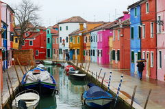 Colorful houses and boats along Burano canal, Venice, Italy Royalty Free Stock Photo