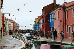 Colorful houses and boats along Burano canal, Venice, Italy Royalty Free Stock Photos