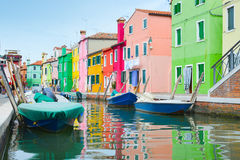 Colorful houses and boats in Burano village Stock Images