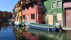 Colorful houses boats and canal of Burano Island in the Venetain Lagoon. Royalty Free Stock Photography