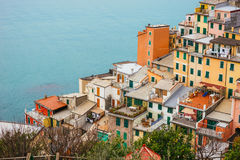 Colorful houses builded on a hillside. Stock Photos