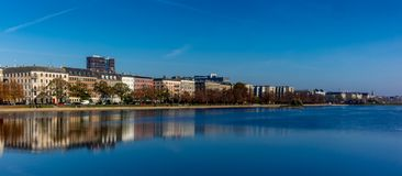 Colorful houses and building reflecting on the artificial lakes in Copenhagen in a warm Autumn day. 1 stock photography