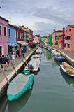 Colorful houses of Burano. The beautiful colorful small houses of the isle of Burano, Venice, on a spring day. Along the sides of  the narrow channel a line of Royalty Free Stock Photos