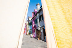 Colorful houses of Burano behind linen Royalty Free Stock Photo