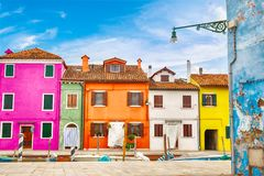 Colorful houses in Burano island with cloudy blue sky near Venice, Italy. Popular and famous tourist place Stock Images
