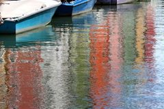 Colorful houses on BURANO island reflected on the water and some Stock Photo