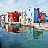 Colorful houses on Burano island in Venice. Beautiful colorful houses and boats on Burano island canal in Venice, Italy Stock Photo