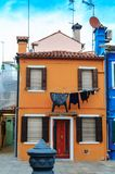 Colorful houses in Burano island. VENICE, ITALY - JANUARY 06, 2018: View on the colorful houses in Burano island, during winter days, Venice, Italy Stock Photos