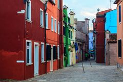 Colorful houses in Burano island. VENICE, ITALY - JANUARY 06, 2018: View on the colorful houses in Burano island, during winter days, Venice, Italy Royalty Free Stock Photography