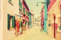 Colorful houses on Burano, near Venice, Italy. Vintage stock image