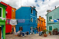 Colorful houses on the Burano, Venice, Italy. Patio with colorful houses and drying clothes on the famous island Burano, Venice, Italy Royalty Free Stock Image