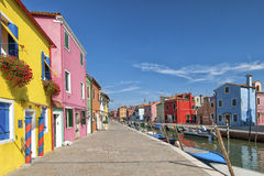 Colorful houses and canal on Burano island, near Venice, Italy. Royalty Free Stock Images