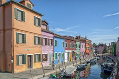 Colorful houses and canal on Burano island, near Venice, Italy. Stock Images