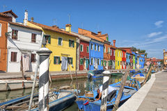 Colorful houses and canal on Burano island, near Venice, Italy. Stock Photo