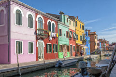 Colorful houses and canal on Burano island, Venice, Italy. Royalty Free Stock Images